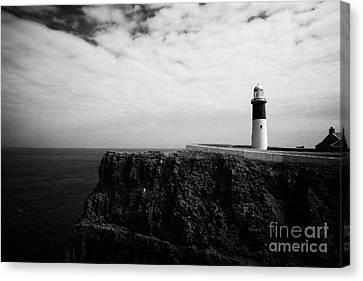The East Light Lighthouse Altacarry Altacorry Head Rathlin Island Against Blue Sea And Blue Cloudy S Canvas Print by Joe Fox