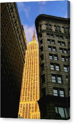 The Empire State Building From Herald Square Canvas Print by Joann Vitali