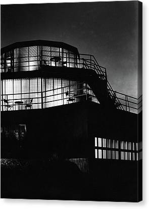 The Exterior Of A Spiral House Design At Night Canvas Print by Eugene Hutchinson