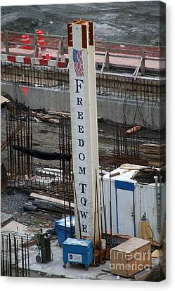 Canvas Print featuring the photograph The First Beam Of The Freedom Tower by Steven Spak