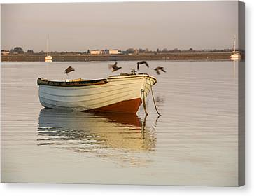 Canvas Print featuring the photograph The Four Flying Boatmen by Trevor Chriss