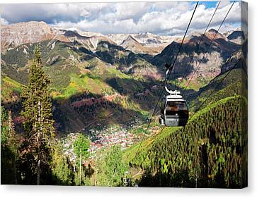 The Free Gondola And The Town Canvas Print by Susan Degginger