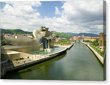 Guggenheim Canvas Print - The Guggenheim Museum Of Contemporary by Panoramic Images
