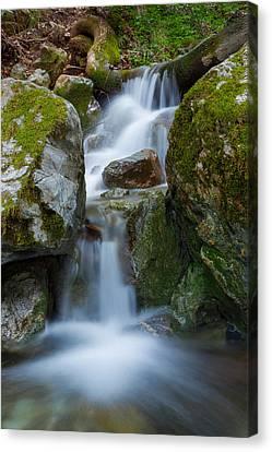 The Hidden Waterfall Canvas Print by Sarit Sotangkur