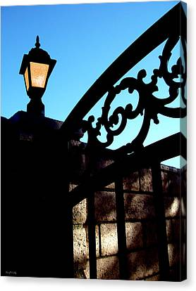 The Light And The Gate Canvas Print by Glenn McCarthy Art and Photography