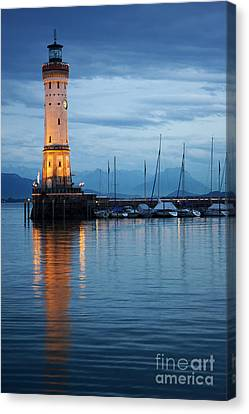 The Lighthouse Of Lindau By Night Canvas Print by Nick  Biemans