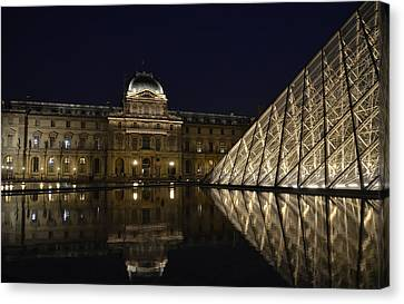 The Louvre Palace And The Pyramid At Night Canvas Print by RicardMN Photography