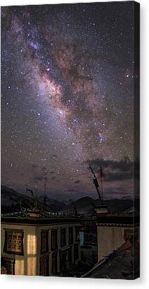 The Milky Way Over A Small Vilage Canvas Print by Jeff Dai