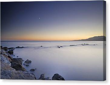 the Moon over the sea Canvas Print by Guido Montanes Castillo