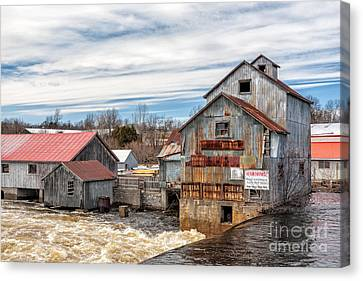 The Old Mill And The Raging River Canvas Print