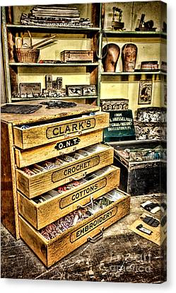 The Old Notions Shop Canvas Print by Olivier Le Queinec