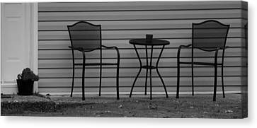 The Patio Chairs In Black And White Canvas Print by Rob Hans
