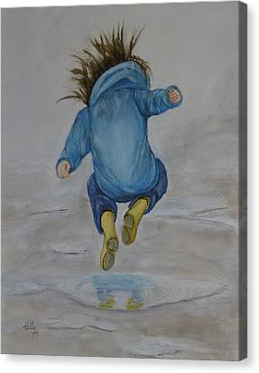 The Perfect Puddle... Jump Canvas Print by Kelly Mills