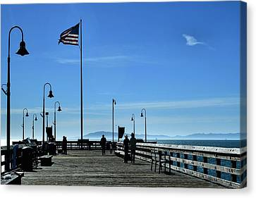 The Pier Canvas Print by Michael Gordon