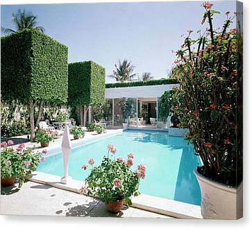 The Pool And Garden Of A Home Canvas Print