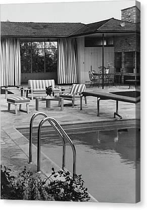 Diving Board Canvas Print - The Pool And Pavilion Of A House by Sharland