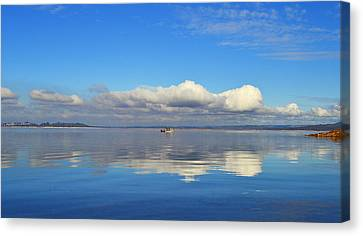 The Sky The Lake And The Boat Canvas Print by Rima Biswas