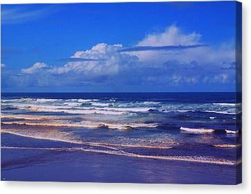 The Tide And Clouds Canvas Print by Jeff Swan