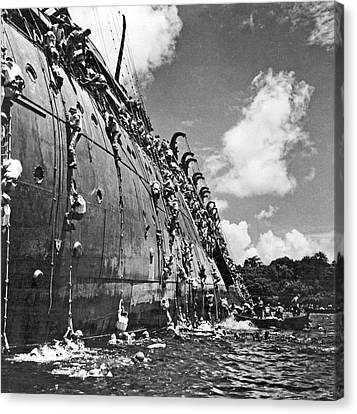 The Troop Carrier, Uss President Coolidge Goes Down In The Harbo Canvas Print by Underwood Archives