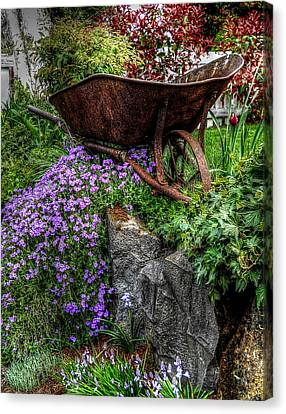 Canvas Print featuring the photograph The Whimsical Wheelbarrow by Thom Zehrfeld