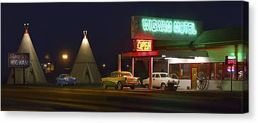 Wagon Wheels Canvas Print - The Wigwam Motel On Route 66 Panoramic by Mike McGlothlen