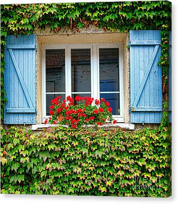 The Window With The Geraniums And The Blue Shutters Canvas Print