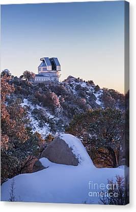 The Wiyn Observatory On Top Of Snow Canvas Print by John Davis