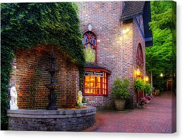 Thomas Kinkade At The Village In Gatlinburg Canvas Print by Greg and Chrystal Mimbs