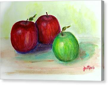 Three Apples Canvas Print by Janet Garcia