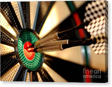 Three Arrows In The Centre Of A Dart Board Canvas Print by Michal Bednarek