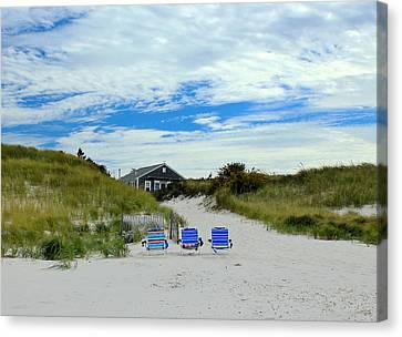 Canvas Print featuring the photograph Three Blue Beach Chairs by Amazing Jules
