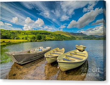 Three Boats Canvas Print by Adrian Evans