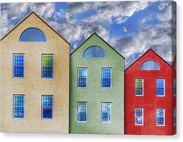 Three Buildings And A Bird Canvas Print by Paul Wear