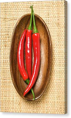 Wooden Bowl Canvas Print - Three Chili Peppers In Wooden Bowl by Foodcollection