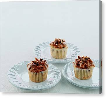 Three Cranberry Cupcakes Canvas Print by Romulo Yanes