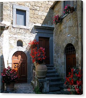Three Doors In Bagnoregio Canvas Print