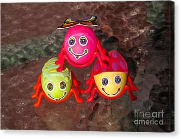 Three Easter Egg Bugs Canvas Print by Sue Smith