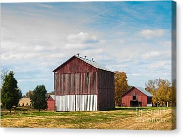 Canvas Print featuring the photograph Three In One Barns by Debbie Green