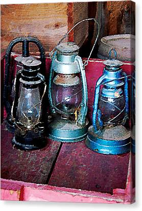 Three Kerosene Lamps Canvas Print by Susan Savad