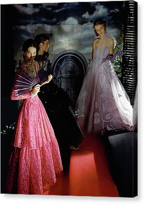 Three Models Wearing Ball Gowns Canvas Print