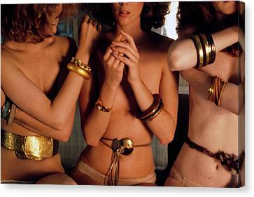Gold Bracelet Canvas Print - Three Models Wearing Bangles And Belts by Deborah Turbeville