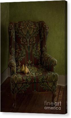 Three Pears Sitting In A Wing Chair Canvas Print by Priska Wettstein