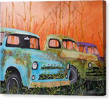 Three Rusty Trucks Canvas Print