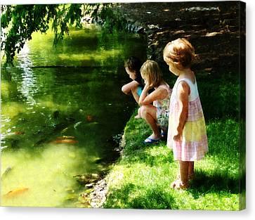Three Sisters Watching Koi Canvas Print