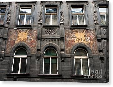 Three Windows In Prague Canvas Print by John Rizzuto