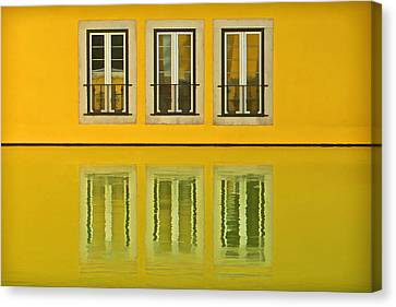 Three Windows Reflecting In The Water Canvas Print