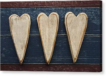 Three Wooden Hearts Canvas Print by Carol Leigh