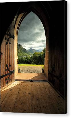 Through The Arched Door Canvas Print by Grant Glendinning