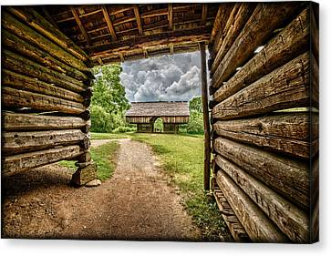 Thunderstorm Approaching Pioneer Barns E130 Canvas Print by Wendell Franks