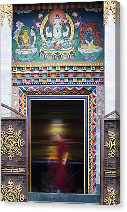 Tibetan Monk And The Prayer Wheel Canvas Print by Tim Gainey